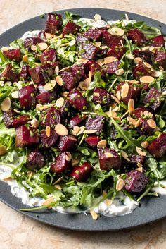 Our method for cooking beets puts this salad on the dinner table in just 30 minutes. Instead of putting the dressing on top, we layer the goat cheese-spice mixture on the plate to help anchor the other ingredients. Beet Salad, Arugula Salad, Salad Bar, Cooks Illustrated Recipes, Beet Smoothie, Smoothies, Dressing For Fruit Salad, Cooking Beets, Goat Cheese Salad