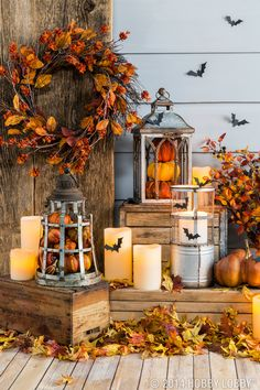 Fill lanterns with pumpkins and other fall pieces for an easy DIY-decor idea.