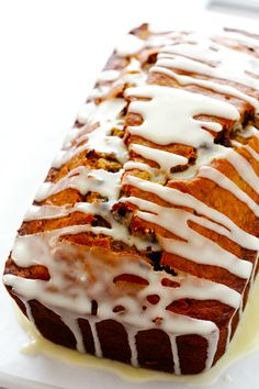 This Cranberry Orange Banana Bread recipe is easy to make, drizzled with a yummy orange glaze, and perfectly moist and delicious! | gimmesomeoven.com