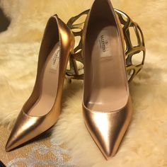 Valentino Rockstud Gold Metallic Leather Pumps These Gorgeous Valentino Pumps in Rose Gold color will make any outfit festive. New without box. Light scratch on right heel. Valentino Shoes Heels