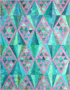 """Mulholland Drive isa fun, fast, fat-quarter friendly quilt that contains diamonds, triangles and a little bit of paper-piecing. This quilt has a modern and slightly aztec feel to it and flies together. The Mulholland Drive quilt pattern contains three sizes: Venti (72"""" x 88""""), Grande (52"""" x 70"""") and Tall (41"""" x 53""""). You will need Letter-Size Foundation Papers to make this quilt. Find them here!"""