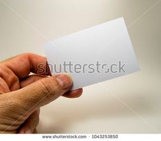 white empty card with a man hand, for free text, on a gray background