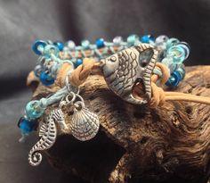 Bohemian bracelet. Hippie bracelet. Beach bracelet. Ocean color bracelet. Blue Glass bead wrap. Angelfish button. Seahorse and clam charms. by KarenMSmithDesigns on Etsy