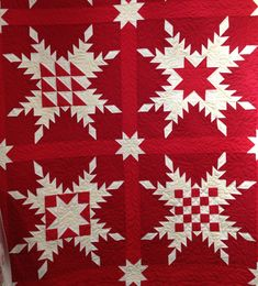 Feathered Star quilt by Anita Peluso of Bloomin' Workshop, made with American Made Brand solids in the red-cream-white color way from Clothworks Textiles. Pattern by Marsha McCloskey,
