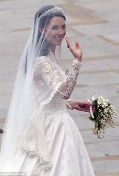 Kate Middleton waves to the crowds outside the Abbey