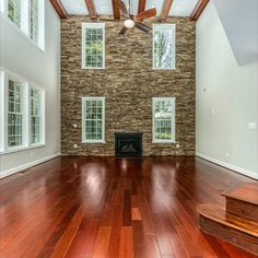 Grand family room with ample natural light, cathedral ceilings with exposed beams, hardwood flooring and a magnificent stone wall with a gas fireplace. Listed for $1,350,000 in Oakton, VA by The Casey Samson Team is a Wall Street Journal Top Team in Northern Virginia.