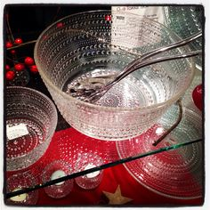 Iittala 'Kastehelmi' meaning 'Dewdrop' in Finnish. Shown here - Salad Bowl, Small Bowls, Cakestand, Tea Lights and Cakestand.