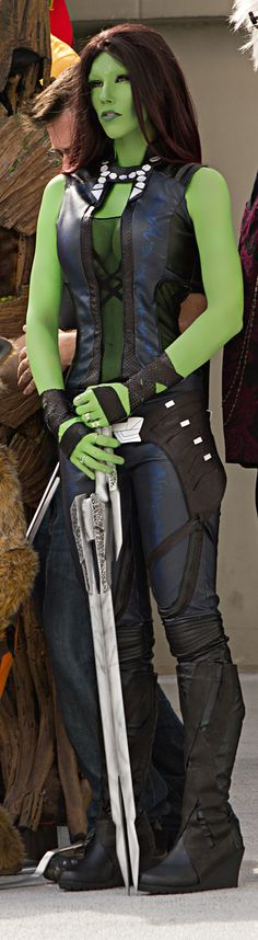 Gamora_Fin female orc ork barbarian fighter gladiator Guardians of the Galaxy cosplay costume LARP armor clothes clothing fashion player character npc | Create your own roleplaying game material w/ RPG Bard: www.rpgbard.com | Writing inspiration for Dungeons and Dragons DND D&D Pathfinder PFRPG Warhammer 40k Star Wars Shadowrun Call of Cthulhu Lord of the Rings LoTR + d20 fantasy science fiction scifi horror design | Not Trusty Sword art: click artwork for source