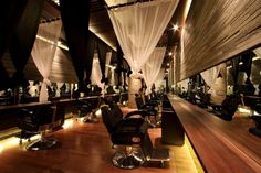 A dark salon with dramatic features