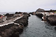 Garachico, south of Puerto de la Cruz, Tenerife provides its visitors with amazing natural swimming area. Local people leveraged the natural rocky shore and created cultivated swimming and relax area. What is more, the village provides many possibilities to grab a meal or enjoy local festivities