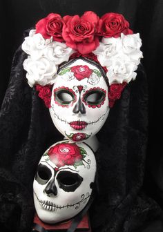 My husband and I got these in a half-mask version. Absolutely AMAZING artistry!! - Till Death Do Us Part, Day of the Dead inspired male/female paired masks. $260.00, via Etsy.