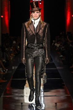 Gaultier's 2012 Fall collection is quite Victorian Dandy.   I both love it and don't, all at once . . . note the corset under the vest, under the tailcoat.  I think I'd like this better on a girl.