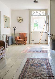 white floors + vintage rugs + Dutch door