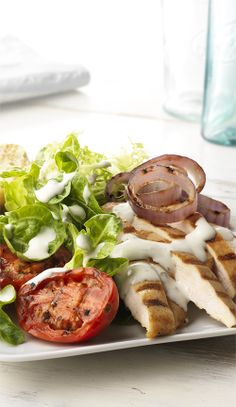 A delicious dish doesn't have to be complicated! Case in point: this salad that combines grilled chicken, tomatoes and onions with salad greens and Simply Dressed Ranch Salad Dressing.  #MarzettiRecipes