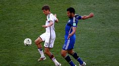 Thomas Mueller of Germany controls the ball against Ezequiel Garay of Argentina Sunday, 13 July 2014 RIO DE JANEIRO, BRAZIL - JULY 13: Thomas Mueller of Germany controls the ball against Ezequiel Garay of Argentina during the 2014 FIFA World Cup Brazil Final match between Germany and Argentina at Maracana on July 13, 2014 in Rio de Janeiro, Brazil. (Photo by Robert Cianflone/Getty Images)   www.dribblingman.com