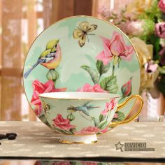 Porcelain tea cup and saucer ultra fine bone china flowers and birds pattern