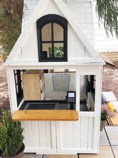 "Our modern ""farmhouse"" makeover of Costco's Greystone Summit Playhouse into our . - The Porche Place - Re-Wilding Backyard Playset, Backyard Playhouse, Build A Playhouse, Modern Playhouse, Playhouse Kits, Plastic Playhouse, Simple Playhouse, Girls Playhouse, Cubby Houses"