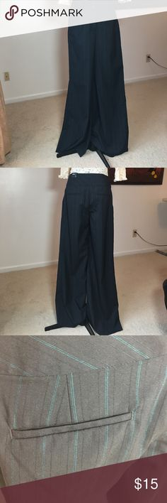 Express Wide Leg Pants NWT Navy blue pinstriped wide leg high rise pants.  33 inches in length original hem.  Thread removed with the intention of hemming to my length, but never got around to it.  So, they need to be hemmed.  The pants are brand new with tags. Express Pants Wide Leg