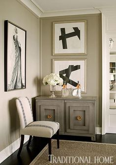 Vignette in the dining room designed by Ken Gemes. Chest is from Hickory Chair | Traditional Home