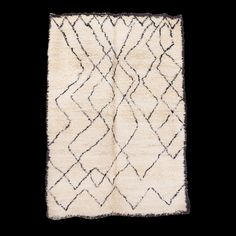 Simple and timeless contemporary rug design with an ivory, cream canvas and black border which encases a ...