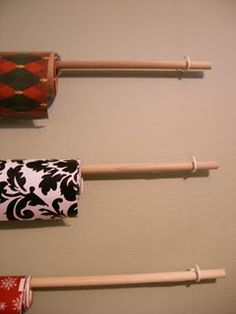 Wrapping paper storage, cup hooks on the wall and 4 ft. dowels to rest on them.  It is slim so they can even go behind a door.