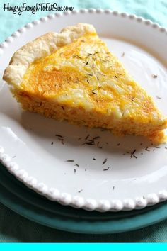 This flaky tart is rich with roasted carrot and onion, with the sharp tang of Cheddar cheese.