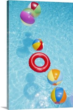 Premium Thick-Wrap Canvas Wall Art Print entitled Beachballs blowing in wind in sparkling blue swimming pool., None