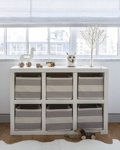 Great storage solution for the nursery or kids room!