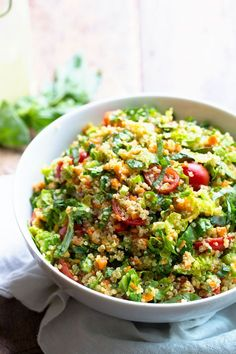 This Herbed Quinoa Garden Veggie Salad is tossed with a lemon herb vinaigrette - so fresh and perfect for summer potlucks or patio dinners. 200 calories.