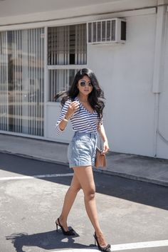 Striped quarter length sleeve top + high waisted light wash denim shorts + black bow heels