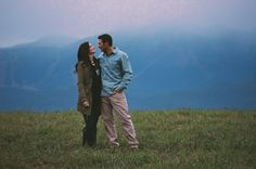 Whitefish, Montana Romantic Engagement Photo in the Field, Big Mountain in the Background.
