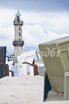 Germany, Rostock, View of lighthouse with beach