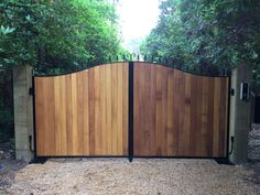 Our Stratford design. Deep metal framed with iroko hardwood timber infill. Mounted on existing gate pillars, automated with a BFT underground system and access via Predator AES gsm intercom system. Wooden Garden Gate, Metal Garden Gates, Metal Gates, Wooden Gates, Wrought Iron Gates, Driveway Entrance, Entrance Gates, Front Gate Design, Door Design