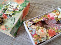 Altered vintage matchbox with a flower garden inside