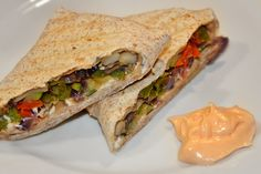 Grilled Mediterranean Veggie Wrap.   Cut and saute veggies, onion, zucchini, peppers, mushrooms, garlic. Season with minced garlic/onion, or whatever you like. toss onto wrap, add cheese..I used goat cheese as I have a small obsession with it. Fold and hold together just long enough to get it into a panini grill press. Grill for 5-7 mins or until you think its done. I was starving, so I didn't leave mine on very long... just enough so that my sloppy wrapping skills wouldn't fall apart on me.