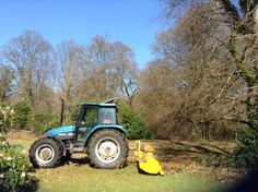 tractor mower getting rid of long grass, briars and lots more besides