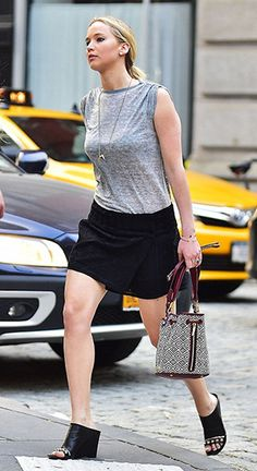 Jennifer Lawrence goes for a stroll in New York's Tribeca neighborhood on June 9, 2015, wearing an Isabel Marant Dewey safety-pin T-shirt, an Isabel Marant necklace, an Elizabeth and James 'Cynnie Mini' Basket Woven Bucket Bag, an Isabel Marant skirt and Balenciaga shoes. #jenniferlawrence #style