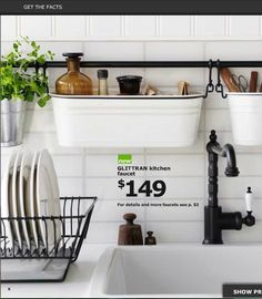 The wall storage would work well in my bathroom! Ikea kitchen catalog 2013  Washcloth and hand towel  holders above toilet.