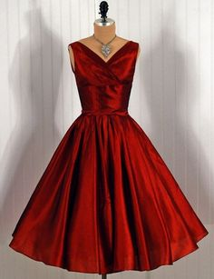 1950's pure silk party dress in fiery ruby-red metallic shimmer, with a low-cut bodice, nipped waist, and full circle skirt. a Jonny Herbert Original.