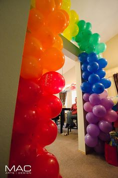 Rainbow balloon arch  We totally need to do this for some event for PRIDE this year!!