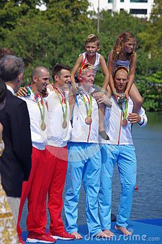 Men double sculls Croatian brothers and rowers Valent Sinkovic and Martin Sinkovic on a podium with gold medals next to bronze medalists from Norway. Picture taken on Aug 11, 2016