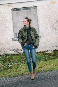 Jess Ann Kirby in Ireland wearing a puffer coat, L.L. Bean fisherman sweater and ankle booties