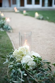 simple and elegant aisle decoration: glass vase + pillar candle + hydrangea + olive branches