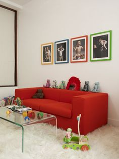 Playroom idea: this photo collage in different color frames is a great idea.