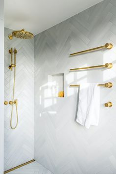 VOLA shower and towel heater in natural brass - Natural brass patinate over time into a unique look. / bathroom / design / home / brass / danish design / white tiles / simple / modern / nordic style / White Bathroom Tiles, Modern Bathroom, Small Bathroom, White Tiles, Bath Taps, Bathroom Faucets, Gold Interior, Bathroom Interior Design, Small Luxury Bathrooms