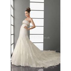 Timeless Strapless A line Tulle Sleeveless Semi Cathedral Train... ❤ liked on Polyvore