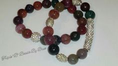 $40 plus shipping. 12 mm Semiprecious Rainbow Agate. Very Heavy. With Pave Bar and Pave Accents.