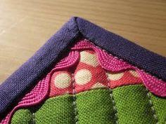 No pins machine sewn binding tutorial.  Also… the rickrack around the edge!