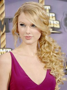 Taylor Swift's Beauty Transformation - 2008: With her signature side bangs and curls at the CMT Music Awards.