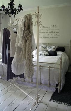 Shabby Chic  plain white bedroom with a touch of black. Love the free-standing clothes rack.